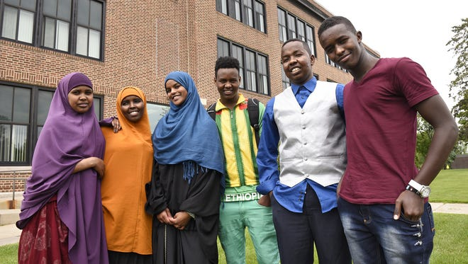 Somali students stand in front of their school following a group meeting of Somali students on May 28 at Tech High School. Students helped craft solutions to issues raised in a protest earlier in the 2014-15 school year.