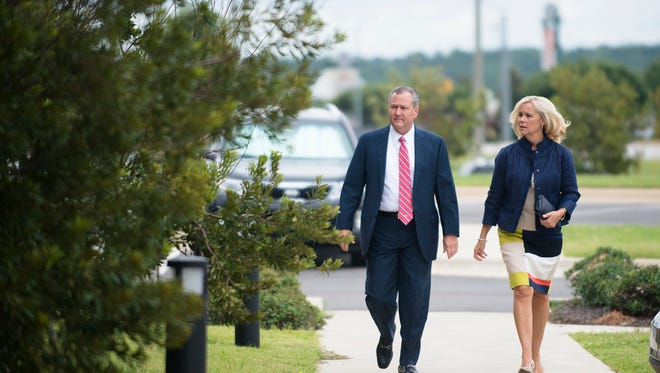 Mike Hubbard, former Alabama Speaker of the House, and his wife, Susan, walk together for a post trial hearing at the Lee County Justice Center in Opelika, Ala., on Friday, Sept. 2, 2016. Hubbard was found guilty 12 counts of felony ethics charges on June 10, 2016.