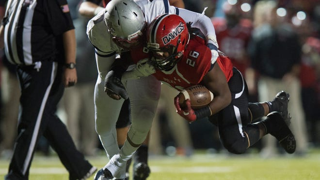 Park Crossing's Mario Davis (6) tackles Opelika's Weldin Ford (26) during the AHSAA State semi-final football game on Friday, Nov. 25, 2016.