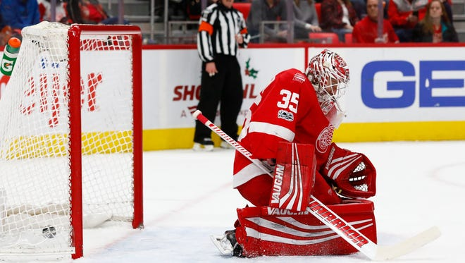 Red Wings goalie Jimmy Howard (35) can't make a save of a shot by Avalanche defenseman Erik Johnson (not pictured) that goes in for a goal in the first period on Sunday, Nov. 19, 2017, at Little Caesars Arena.