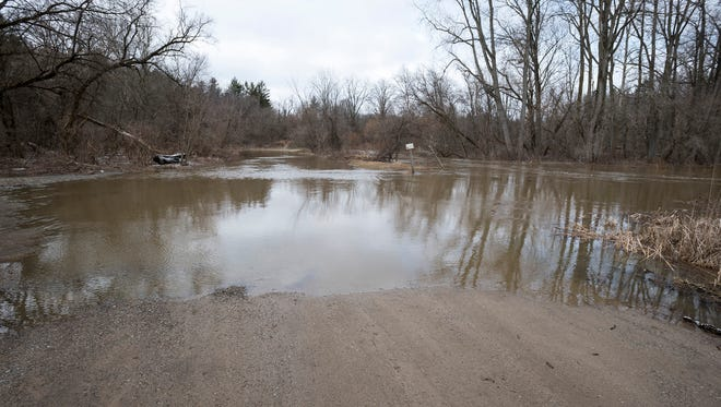 The Black River floods into a wildlife area in North Street Tuesday, April 17.