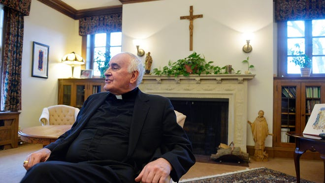 Bishop Donald Kettler talks after a meeting he helped organize for leaders of different faiths in the community Thursday at the St. Cloud diocese chancery in St. Cloud.