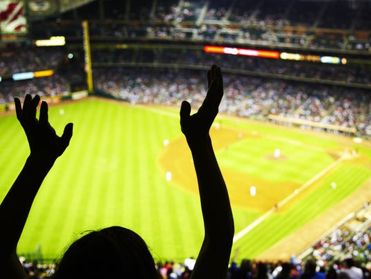 Silhouette of Baseball fan waving hands in the air