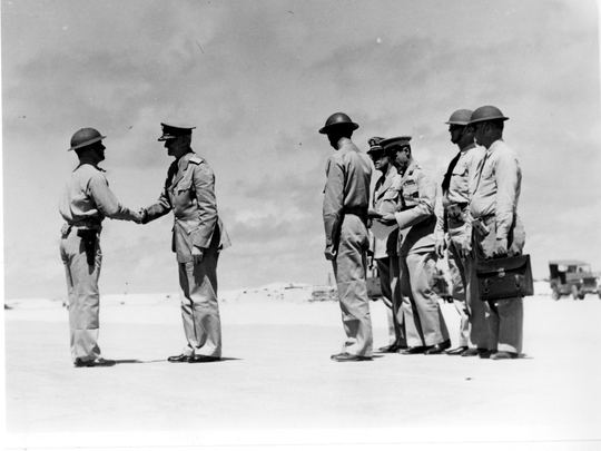 Marine Lt. Francis P. McCarthy is congratulated by Adm. Chester W. Nimitz after being presented with the Distinguished Flying Cross for his part in shooting down a Japanese aircraft during the Battle of Midway.