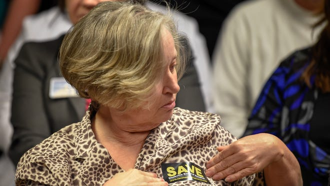 Miralee Spain places a sticker on her chest in support of Nashville General Hospital during the Hospital Authority Board meeting at Nashville General Hospital  in Nashville, Tenn., Friday, Nov. 17, 2017.