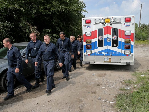 IMPD, IFD and the IMPD recruit class continued their search for 6-week-old Delano Wilson near the railroad tracks off of Harding Street and West Morris Street Friday, August 29, 2014, afternoon. Here the IMPD recruit class calls it a day and walk back to their vehicles.