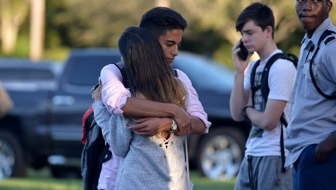 "Jorge Zapata,16, a student at Marjory Stoneman Douglas High School in Parkland, embraces his mother, Lavinia Zapata, after a mass shooting earlier in the day at the school. ""I was just really incredibly, indescribably happy to see him, because you never know,"" Lavinia Zapata said."