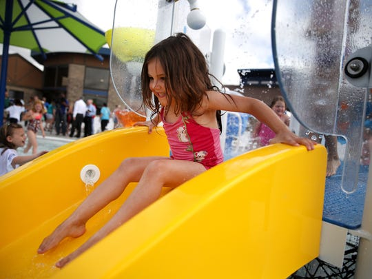 Kaiya Wyland, 4, of Appleton, gets ready to go down a slide in the Splash Pad during the grand opening of the Erb Park Pool Wednesday, July 12, 2017, in Appleton, Wis.Danny Damiani/USA TODAY NETWORK-Wisconsin