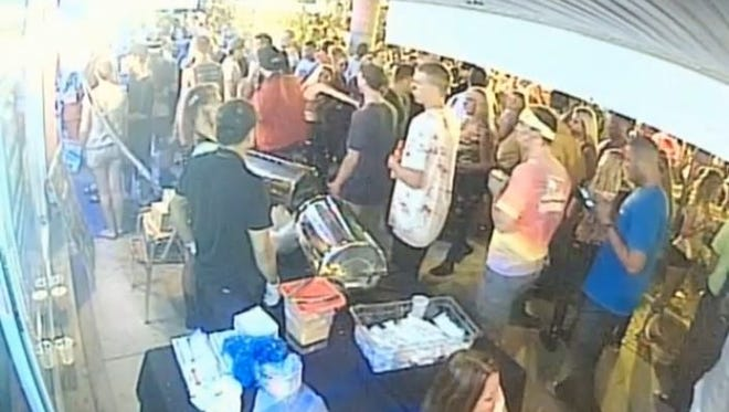 Police are asking for help to identify people seen in surveillance footage outside of Los Cabos Cantina seconds before the Zombicon shooting.