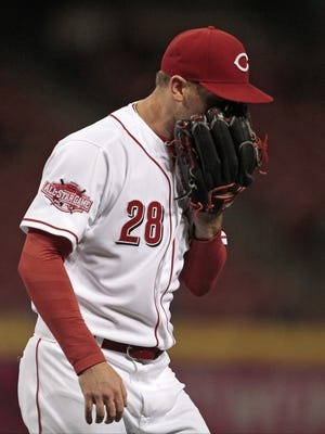 Cincinnati Reds starting pitcher Anthony DeSclafani (28) yells into his glove as he comes off the mound following the fourth inning of the MLB game between the Cincinnati Reds and the Chicago Cubs at Great American Ball Park in Cincinnati on Wednesday, Sept. 30, 2015.