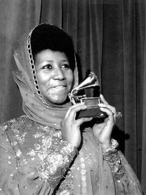 Aretha Franklin poses with her Grammy Award at the