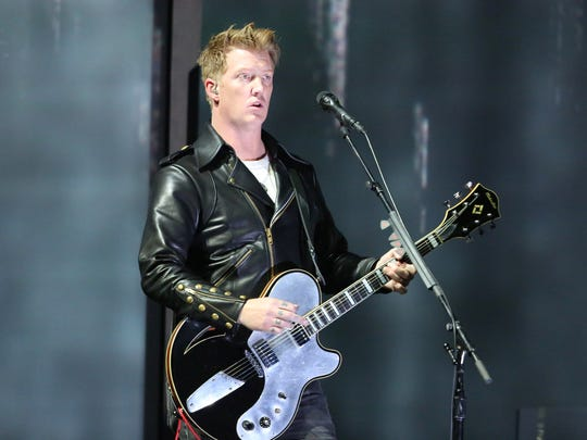 In this Jan. 26, 2014 file photo, Joshua Homme, of Queens of the Stone Age, performs at the 56th annual Grammy Awards in Los Angeles. Homme is scheduled to perform Saturday with Iggy Pop at Cal Jam 18 in San Bernardino.