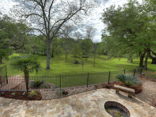 This home sits on more than an acre of beautifully landscaped property.