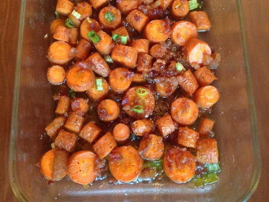 These carrots are cooked with maple syrup and bacon,