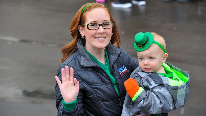 Renata Stiehl from WENY and her son march in a previous Horseheads St. Patrick's Parade.