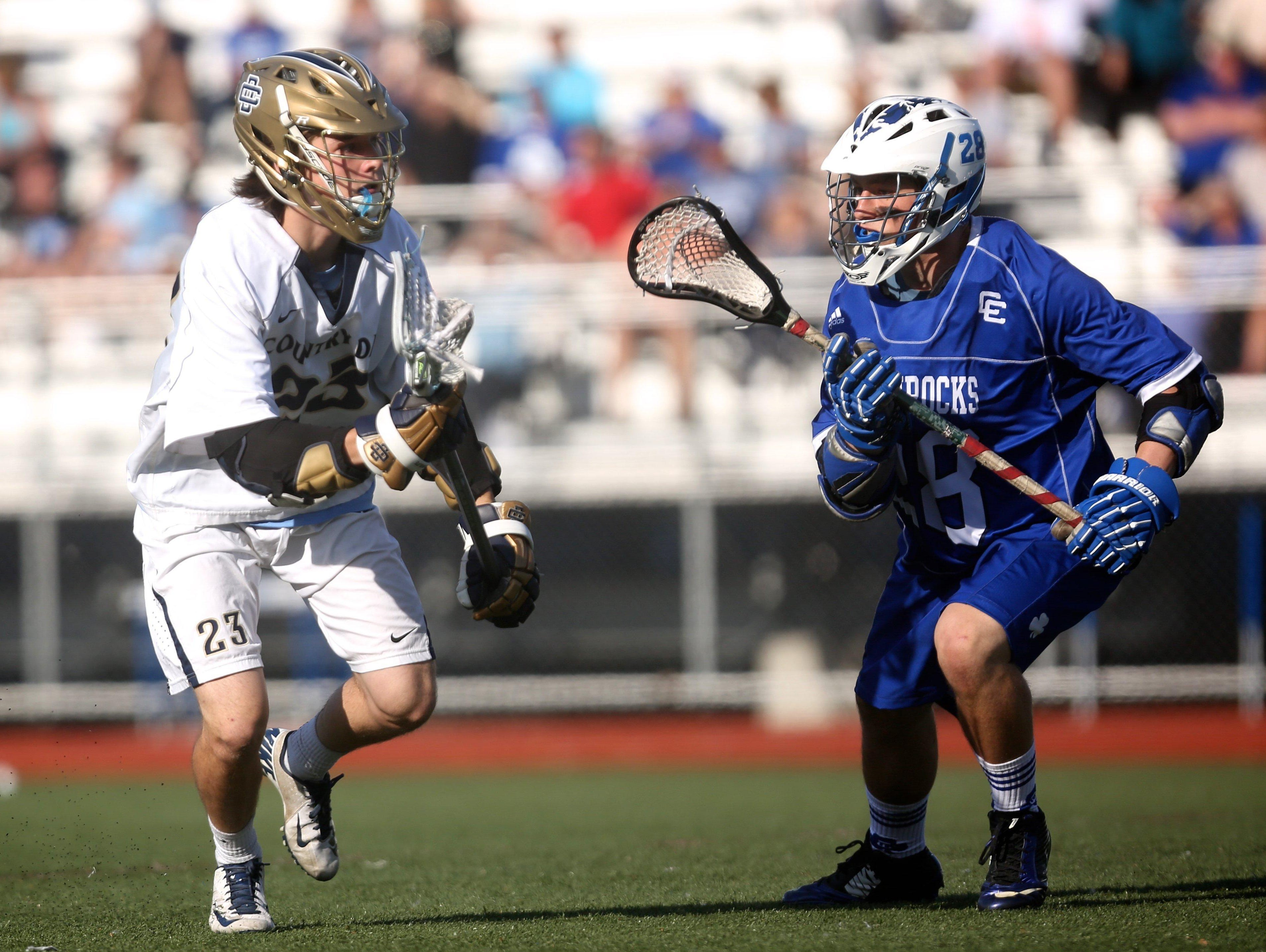 Birmingham Detroit Country Day's Brendan Dolan runs to the goal past Novi Detroit Catholic Central's captain Matthew Foreman during Catholic Central's 14-13 win to advance to Saturday's Division 1 state final.