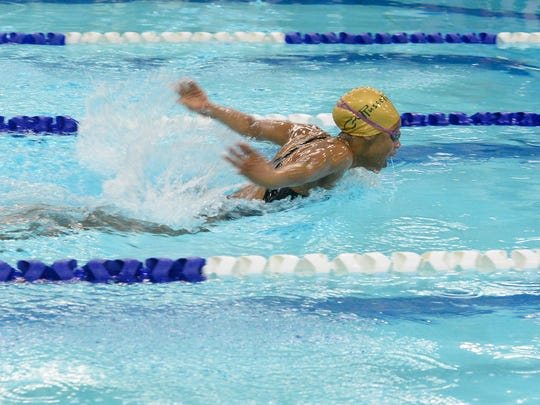 CMR's Ayana Gray competes in the 200-yard IM during the crosstown swim meet on Thursday.