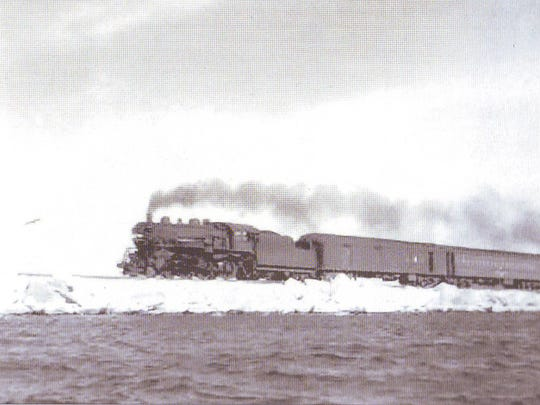 The Island Line steams across the causeway from South Hero to Burlington. Built in 1899, the causeway supported train traffic until the early 1960s and was converted to a recreation path starting in the mid-1990s.