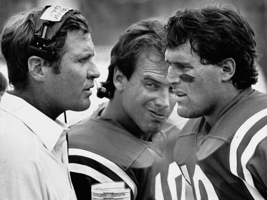 Former Indianapolis Colts coach Rod Dowhower (left) had an intense discussion with starting quarterback Mike Pagel (right) during a game in the 1985 season, as Art Schlichter (center) listened in. The Colts went on to lose that game and finished 5-11 that season, both quarterbacks' last with the Colts.