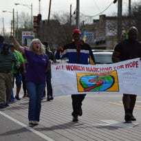 Marchers raise awareness about domestic abuse