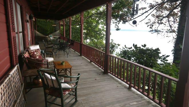 A covered porch faces Canandaigua Lake.