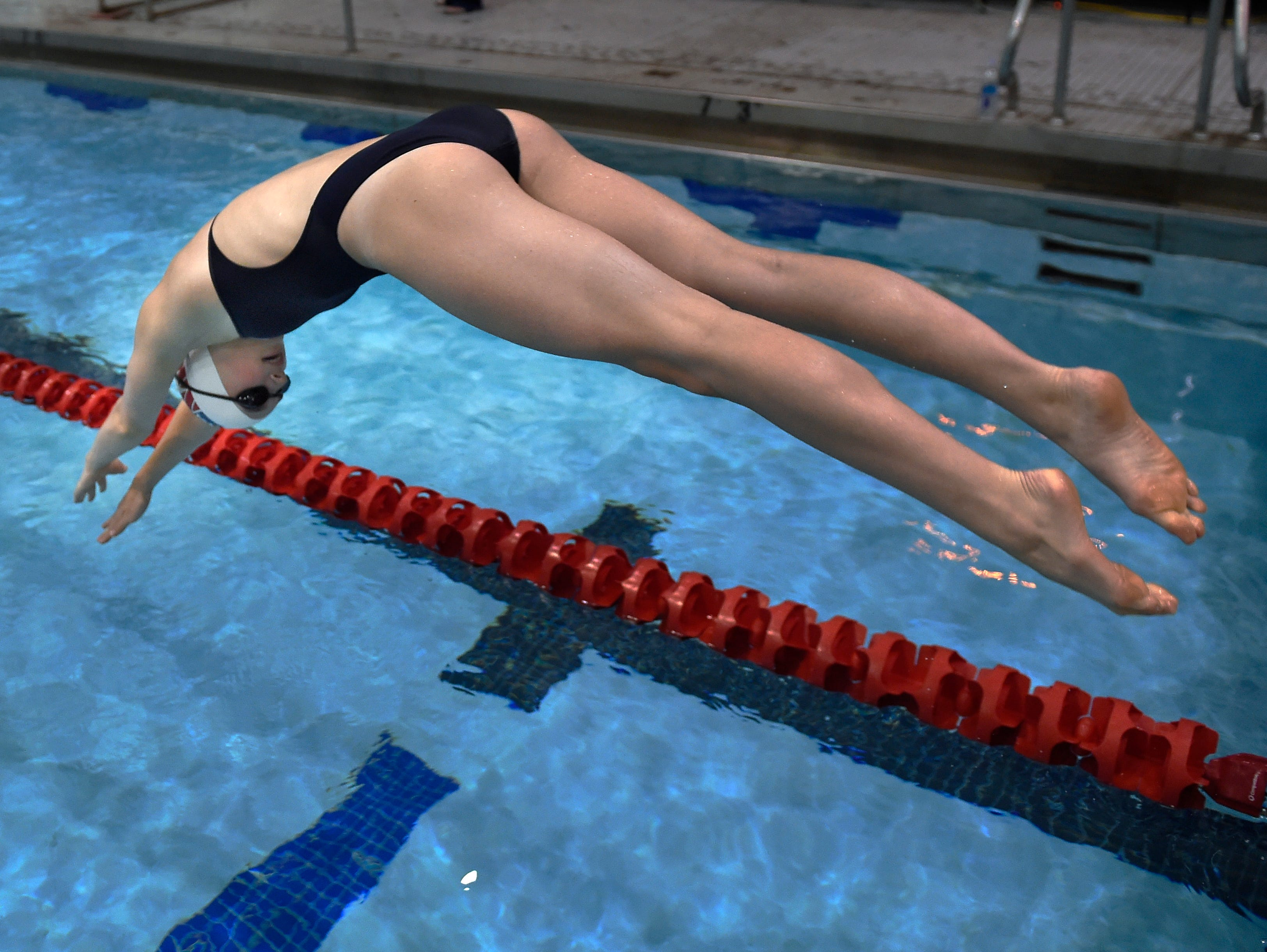 Alex Walsh dives into the pool as she practices for the Olympic Trials Wednesday, June 22, 2016, in Nashville, Tenn.