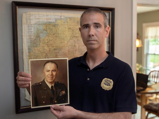 Wall Township police officer Mike Malone holds a photo of General Harry Rockafeller.