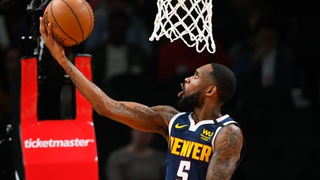 Denver Nuggets guard Will Barton shoots a reverse layup during an NBA basketball game against the Atlanta Hawks, Monday, Jan. 6, 2020, in Atlanta. (AP Photo/John Amis)