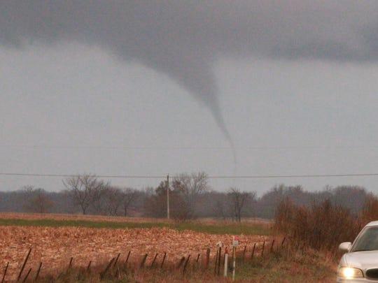 A funnel cloud races across the Iowa plains. The National