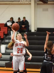 Norfork's Ivy McGowan puts up a shot during the Lady