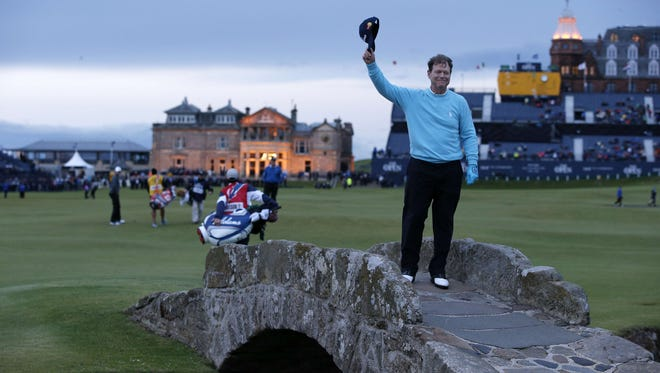 Tom Watson waves to the crowd from the Swilcan Bridge Friday.