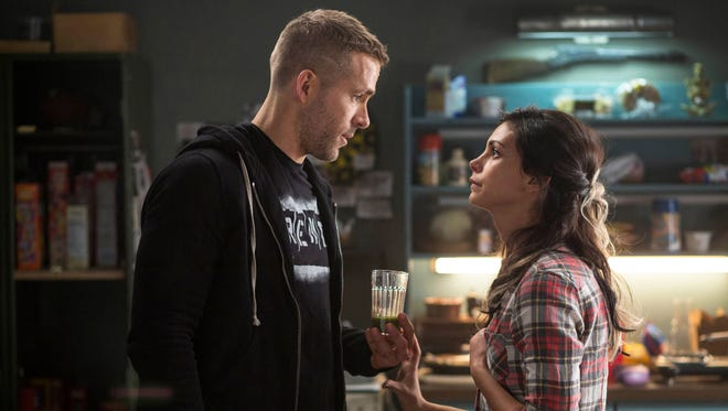 """This image released by Twentieth Century Fox shows Ryan Reyonlds, left, and Morena Baccarin in a scene from the film, """"Deadpool."""""""