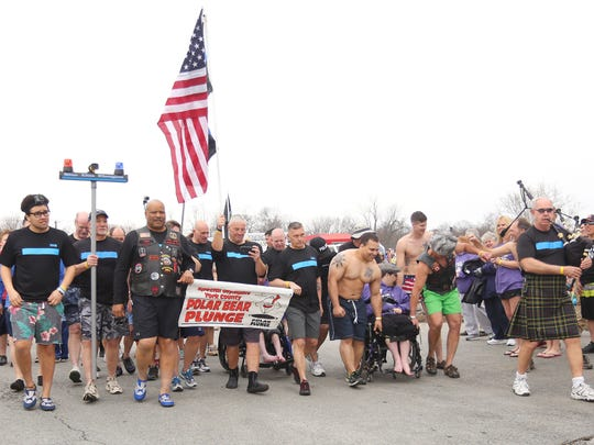 The Blue Line Plungers, made up of York County police officers, sheriffs and friends, walk together as a unit to participate in the first wave of the Polar Bear Plunge Saturday, March 5, 2016, in Wrightsville, PA. The Plungers raised $14,000 for the York County Special Olympics. Amanda J. Cain photo