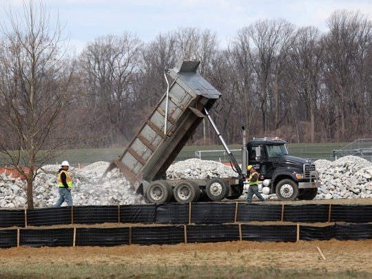 Crews work on the new U.S. 301 tollway that will run behind Appoquinimink High School near Bunker Hill Road in Middletown on Thursday. The area has a high number of long-distance commuters.