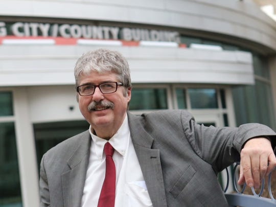 John Flaherty, director of the Delaware Coalition for Open Government, in front of the Louis L. Redding City/County Building.