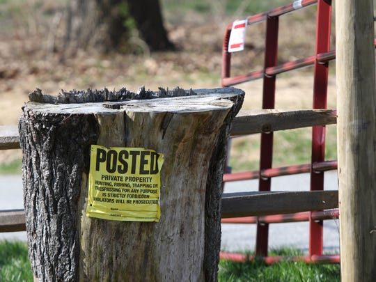 Private property signs on the grounds of the former Delaware National Country Club are shown Monday. A plan to develop housing on the site have been in legal limbo for years.