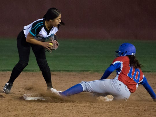 Oñate's Alyssa Reyes gets the out as Las Cruces High's