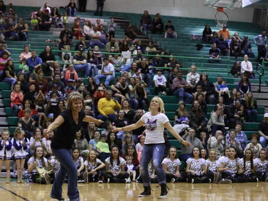 Sheila Mobley, left, and her daughter, Crista Farmer, finish up a dance routine for the families of their students on Thursday April 28, 2016, at Farmington High School.