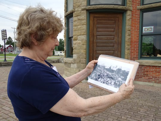 Karen Scott looks at a photo that is believed to be