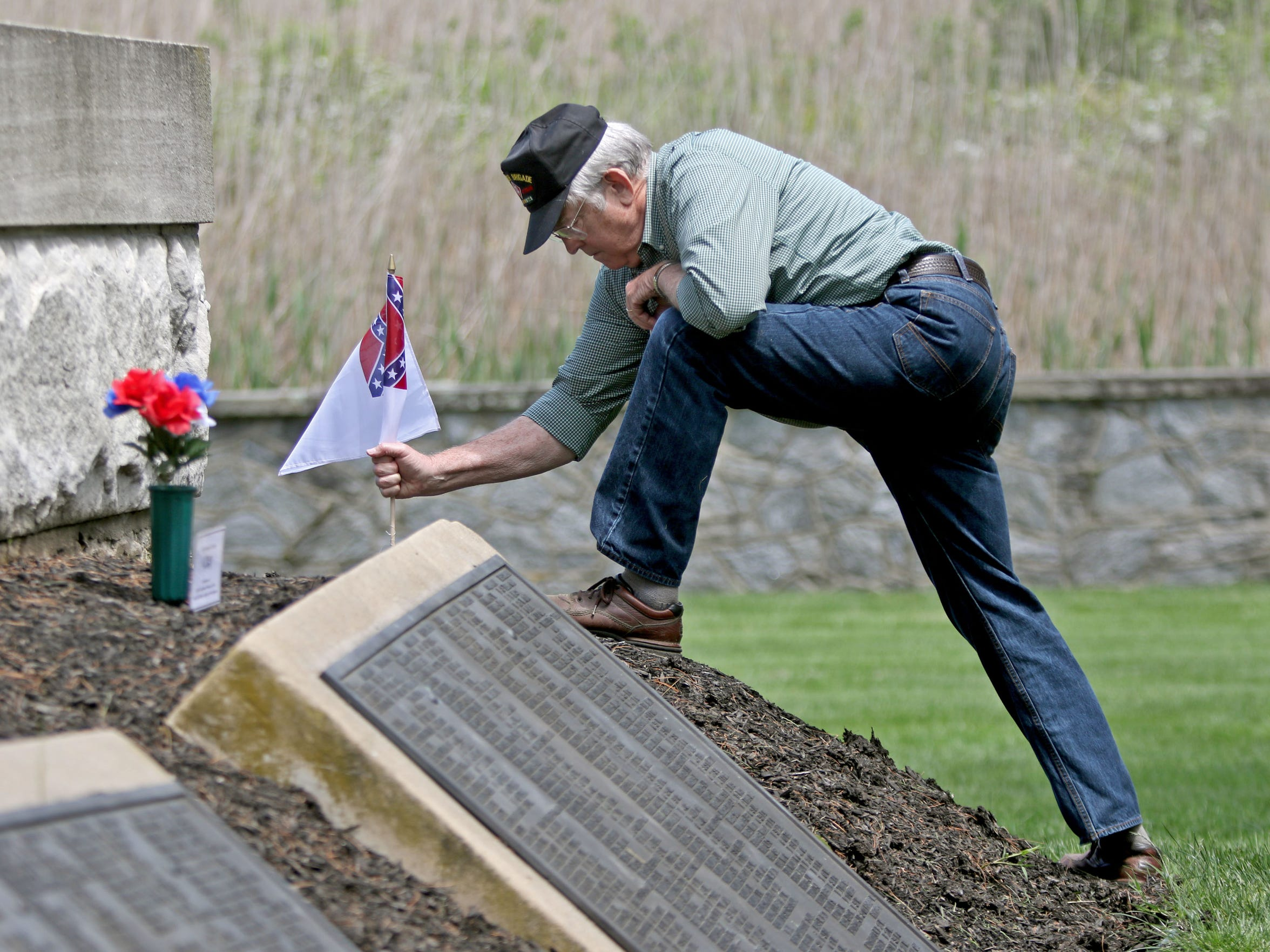 R. Hugh Simmons with the Fort Delaware Society, to puts memorial flags around a monument with the names of Confederate soldiers in Finn's Point National Cemetery in Pennsville, N.J. The soldiers died when they were on Pea Patch Island, Fort Delaware, during the Civil War.