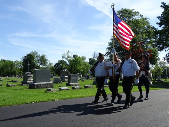 The color guard carries Old Glory into Oakwood Cemetery