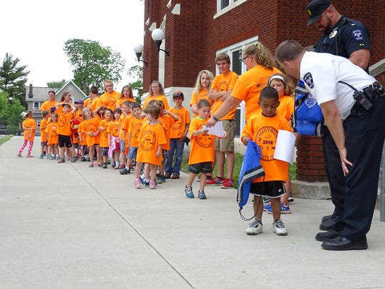 Bucyrus Police Chief David Koepke congratulates kindergartners as they graduate from Safety Town on Friday afternoon.