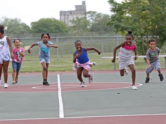 Left to right, )Saniyah Richardson, 7, Kameira Austin, 5, Ava Fassett, 6, Asiyih Ringgold, 7, Asani Watson, 7, and Jaiden Guardarrama, 6, all play a game of red light green light during the Wilmington Housing Authority empowerment fair at Kingswood Community Center on Wednesday.
