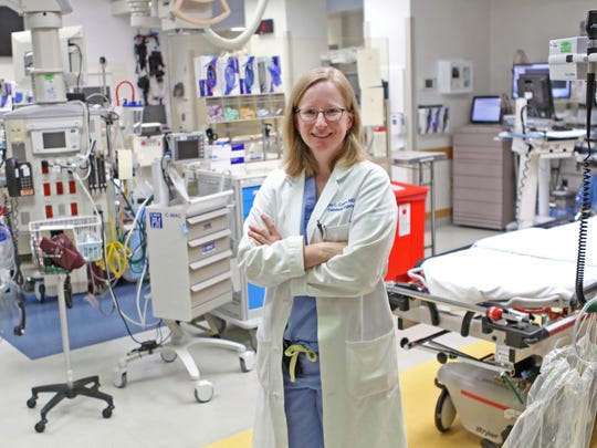 Dr. Joy Collins, a trauma surgeon at CHOP, stands in the emergency room next to the bed where a team of doctors worked on10 year-old Emily Ruckle saving her life from a near deadly Pit bull attack on Sept. 27th 2014.