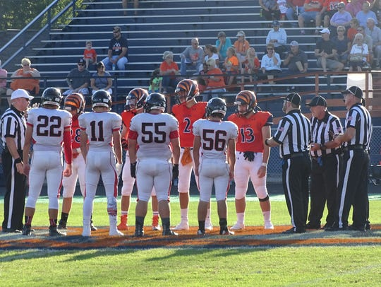 The Galion Tigers and the Bucyrus Redmen wait for results