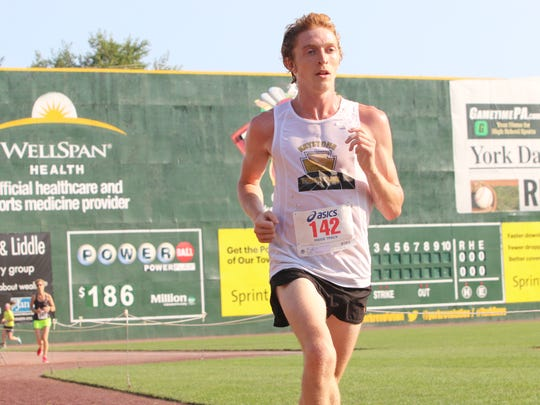 Dylan Mountain takes the course at PeoplesBank Park during the  8th Annual Quarterback Club of York 10K & 5K on Sunday. Mountain finished first overall in the 10K race with a time of 32 minutes, 10 seconds.