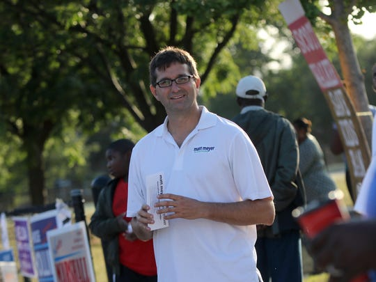 New Castle County executive candidate Matt Meyer campaigns outside Harlan Elementary School Tuesday morning. He defeated incumbent Thomas P. Gordon in a surprise victory Tuesday.