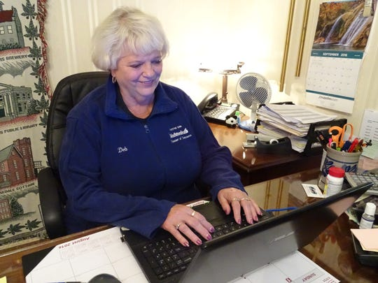 Deb Pinion, director of the Bucyrus Chamber of Commerce, answers a few emails Friday before meeting with a representative of Fostoria who wanted her advice on ways to beautify a city's downtown. Pinion will retire at the end of October after 21 years of service.