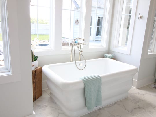 A custom tub in the master bath adds luxury to the