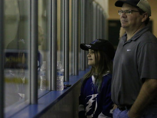 Fans watch the Tampa Bay Lightning practice during Tuesday morning's open practice at Germain Arena in Fort Myers.